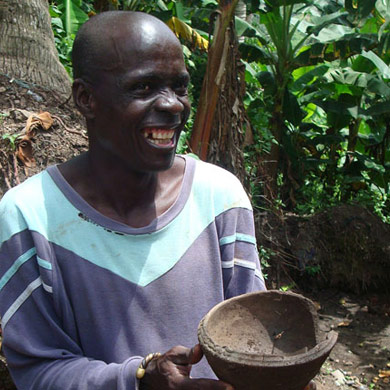 Kwame Sasah, a local elder, displaying local ceramic bowl - surface find