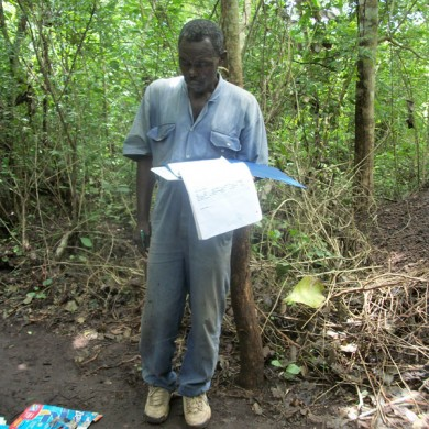 Ghana museum staff updating field records at site