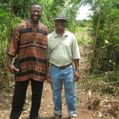 UCC professor visits with project director during excavation